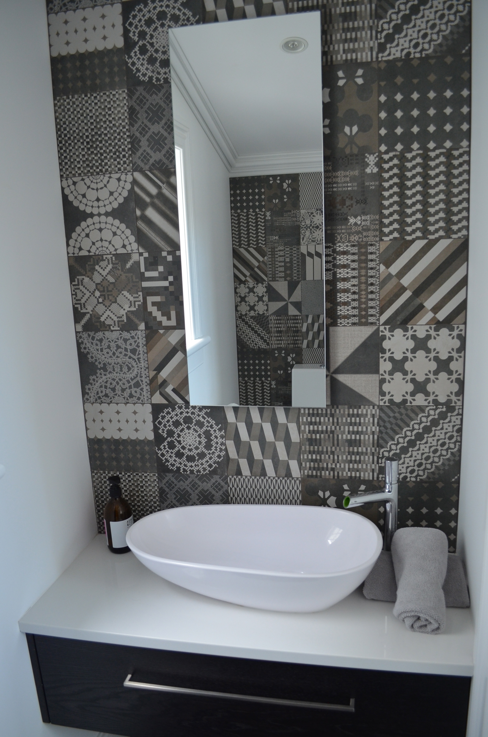 feature tiles to powder room.jpg