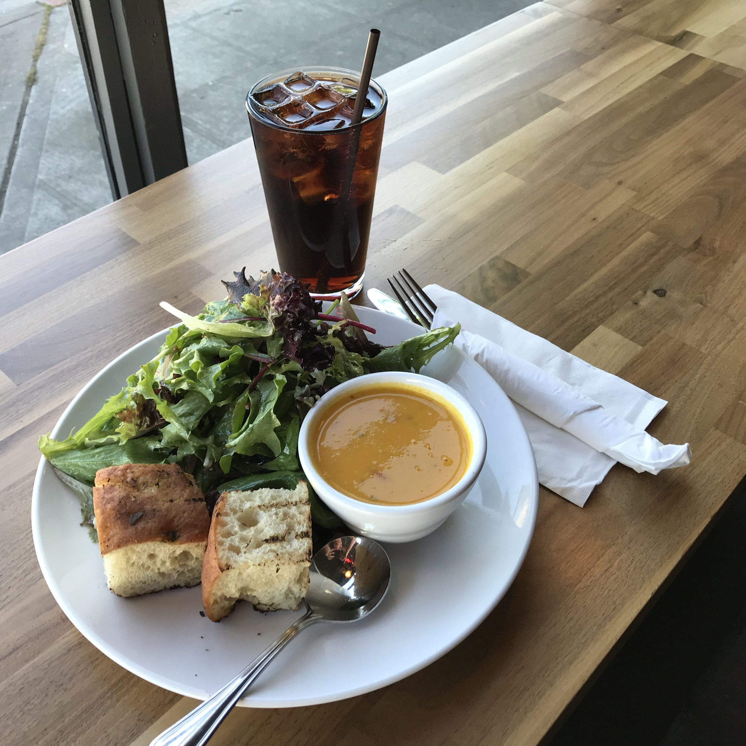 CUP OF SOUP & GREENS - We always have a veggie (or vegan) soup and a meat soup option. They're made in house and rotate throughout the week. Served with Grand Central Bakery bread.