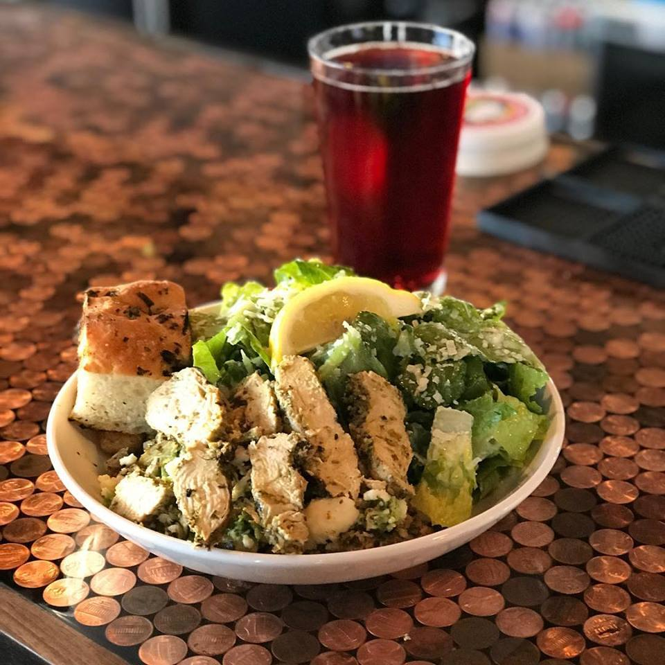 CAESAR SALAD - Romaine lettuce with our house made Caesar dressing, shaved Parmesan, cracked pepper and garlic croutons. Add any protein for $4