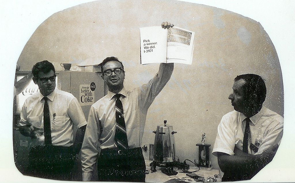 """""""Future Intel CEO Andy Grove holds Intel 3101 ad in 1969."""" Photo by  Intel Free Press , licensed under  CC BY 2.0 ."""