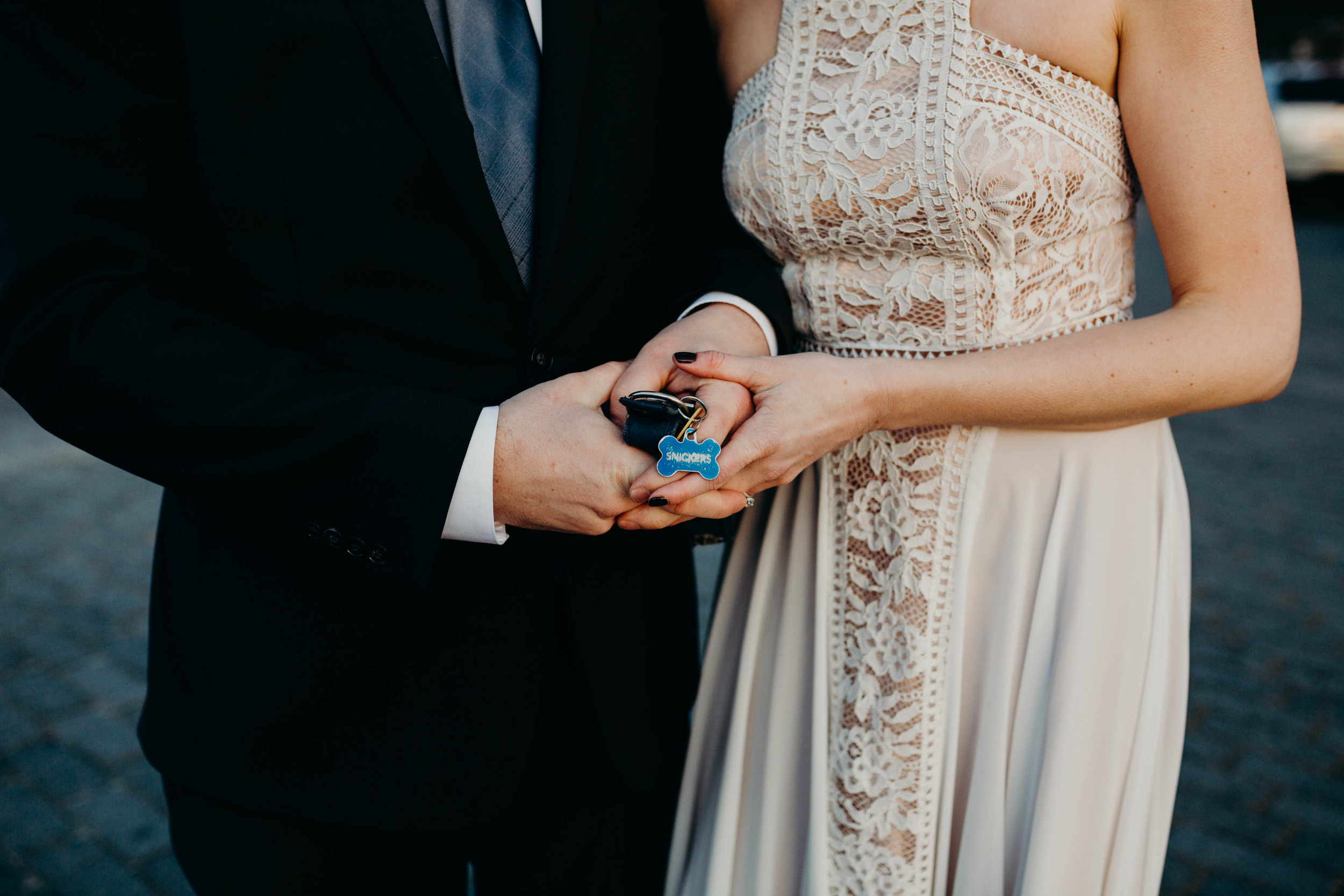 This dog tag was in honor of their sweet pup, Snickers, who was supposed to be their flower girl but unfortunately passed a few weeks before the wedding day.