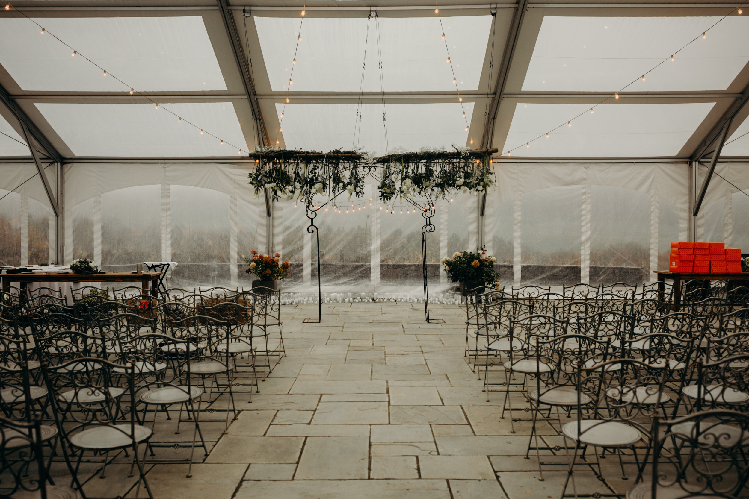 Due to rain, the ceremony had to be moved to the inside of the tent, but I think it's for the best in this case.