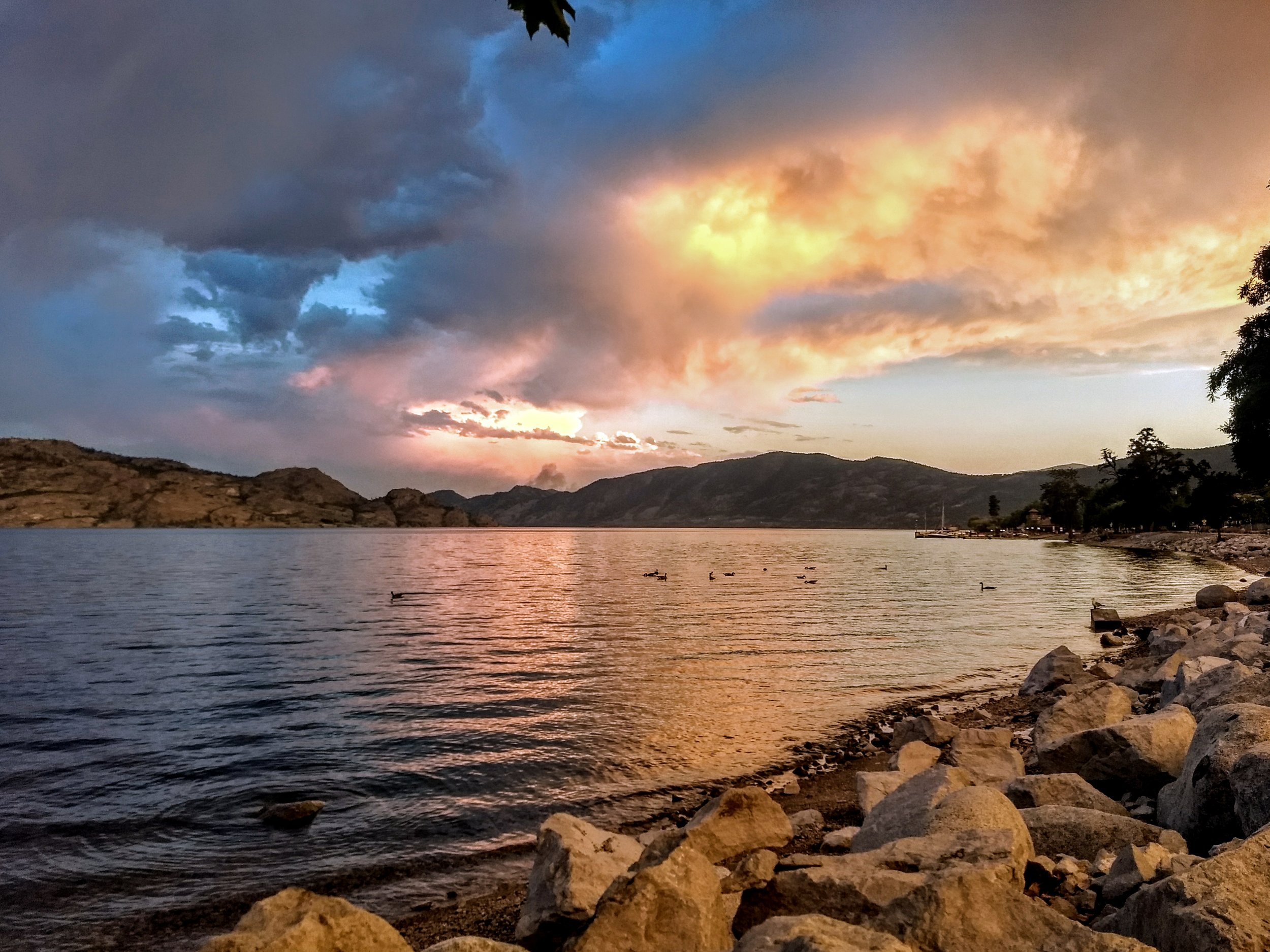 The rocky shores of Lake Okanagan are the perfect setting for unforgettable summer sunsets.