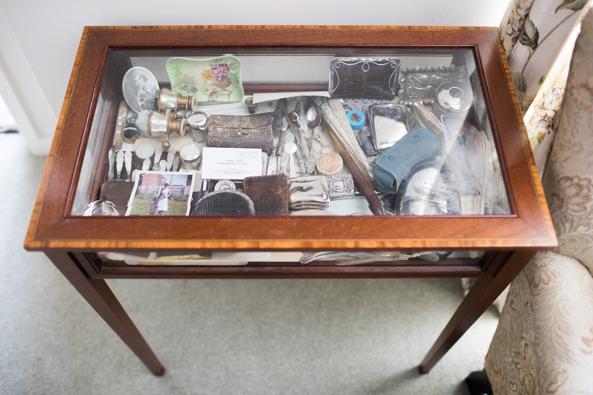 As a child I used to spend hours taking all the little trinkets out of this display case and putting them back in again. vintage tweezers, a clothes brush, old binoculars to take to the opera... This case has such history and everything in it has a story to tell. Maybe I should shoot everything individually along with its story?