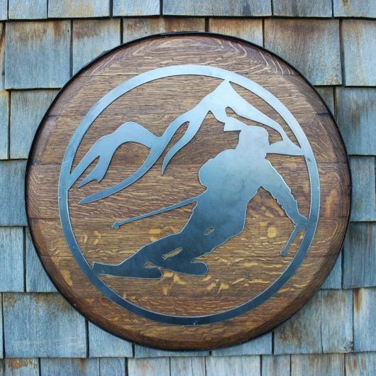 Skier Metal Sign on Barrel lid