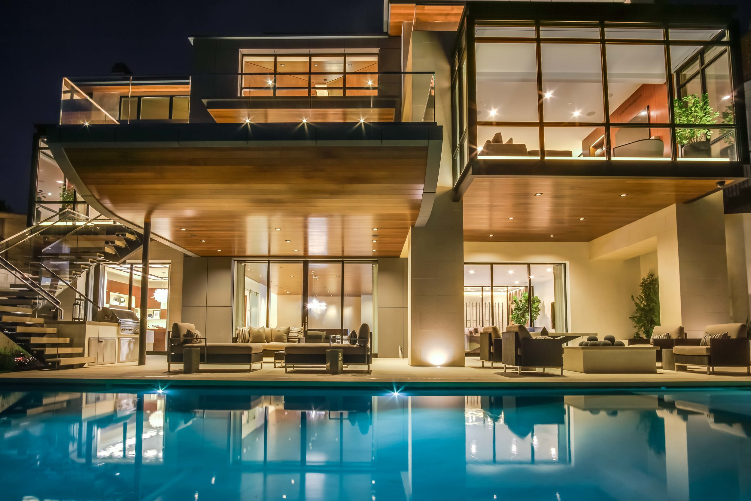 Exterior twilight photograph of luxury home in Newport Beach that was voted Modern house design of the yearBuilt by spinnaker Development and designed by details a design