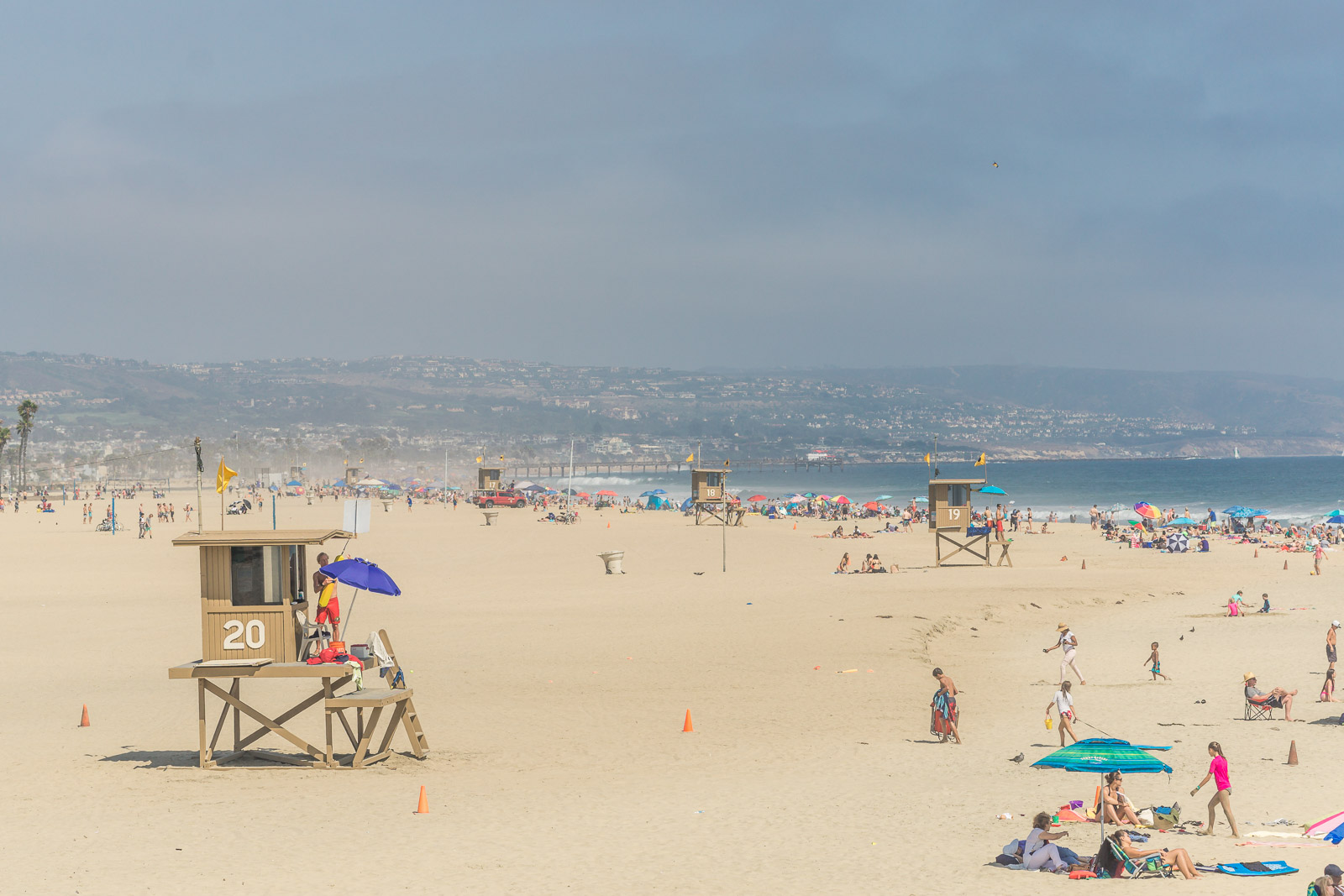 view from Newport Beach pier on a Sunny day overlooking the beach and Ocean