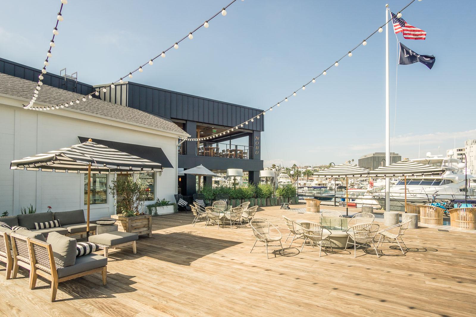 Lido Marina outdoor patio with restaurants andHarbor view from Nobu restaurant and Zinque restaurant
