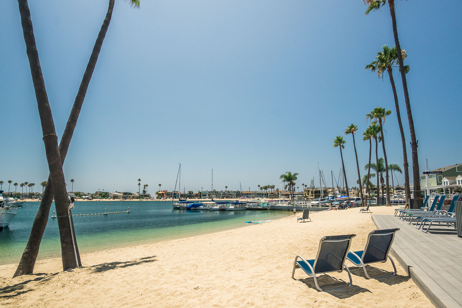 Lido Island beach with palm trees and lounge shoes