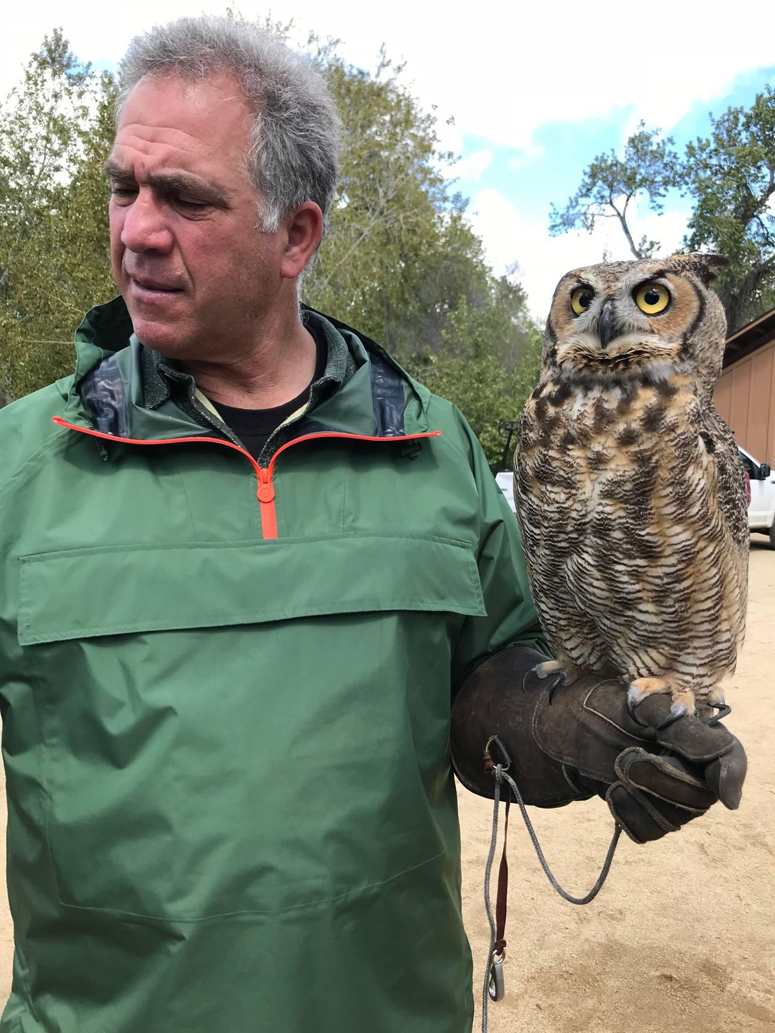 Antonio Belestreri with a Great-Horned Owl