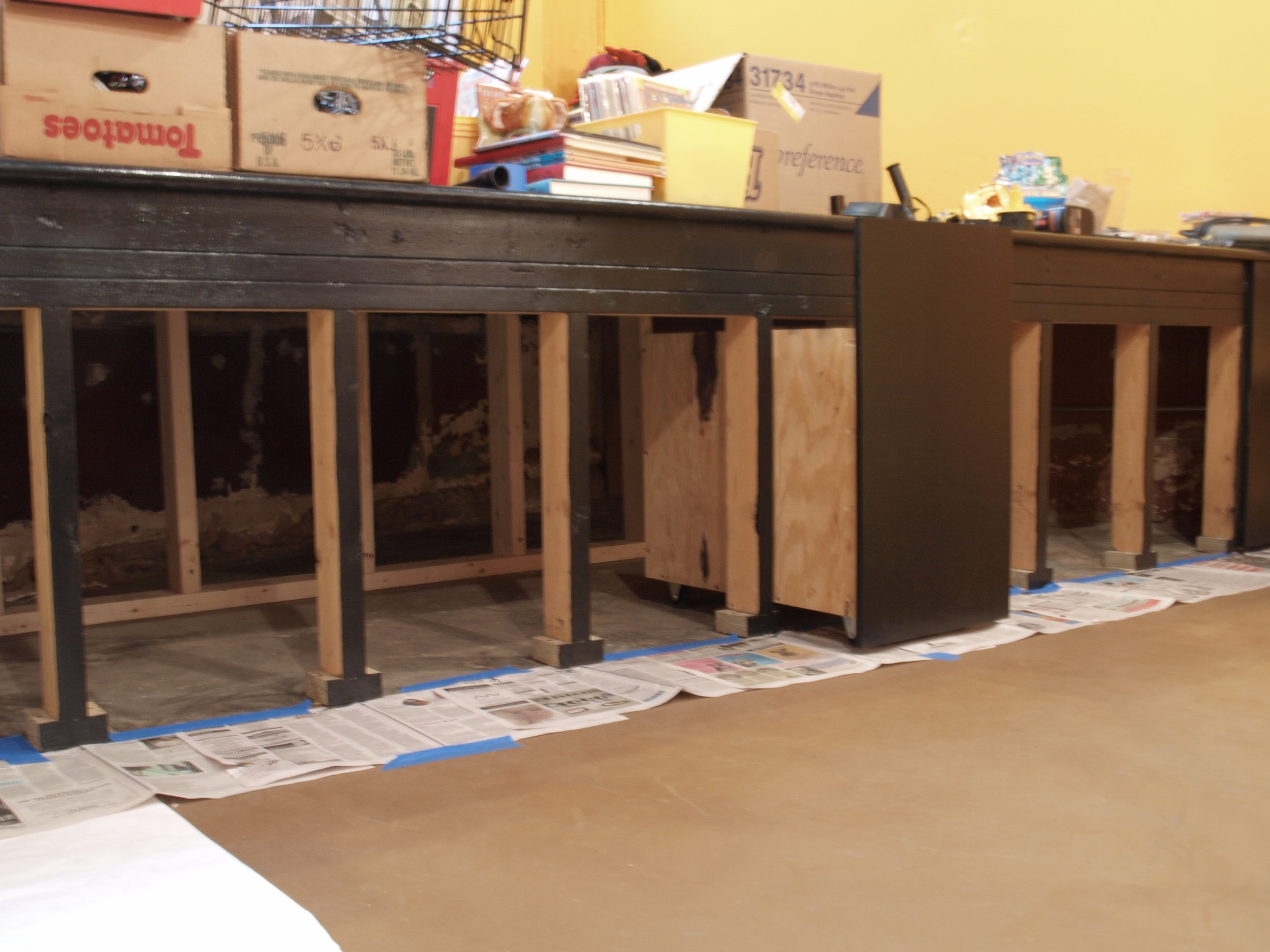The space came with a stage which did double duty for us after we reinforced the structure and built rolling carts to hold overstock merchandise and supplies underneath.