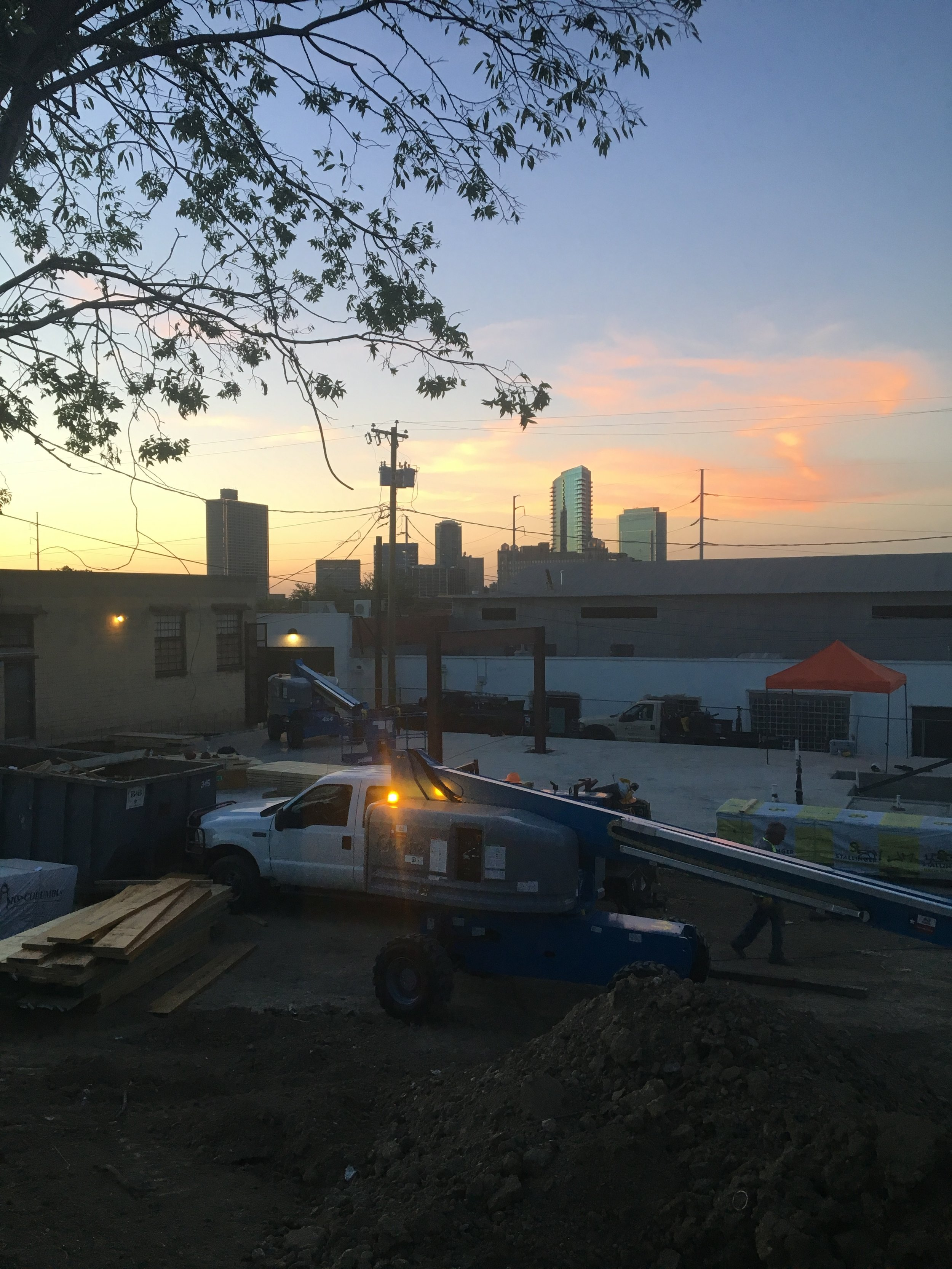 Looking north towards downtown at sunset - we're so excited to our sunset views on the rooftop deck!