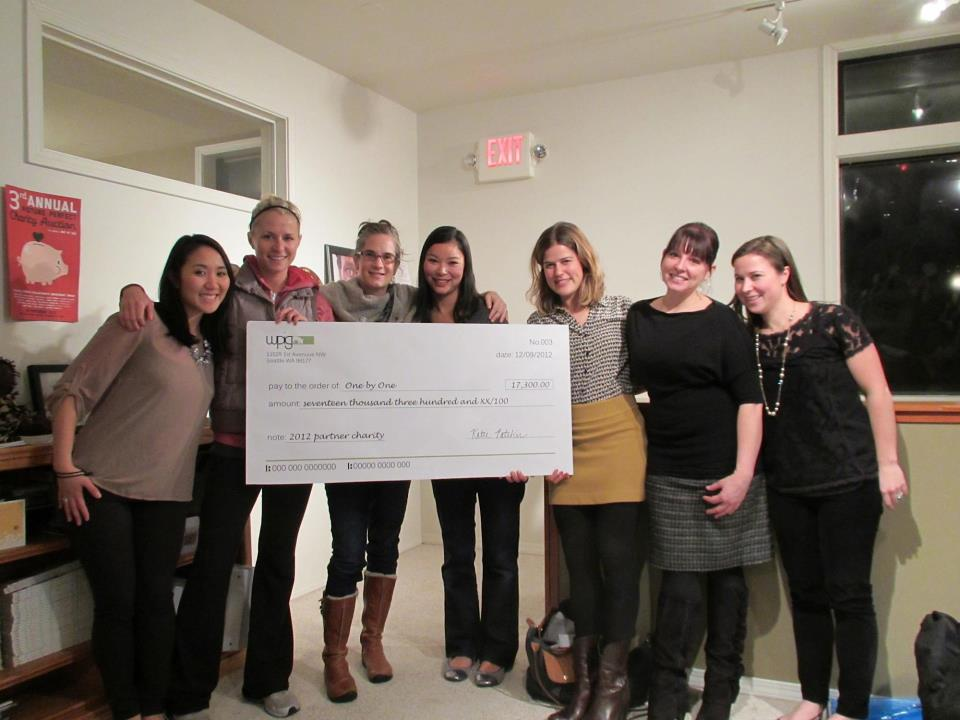 WPC members present the 2013 Annual Partner One by One with a check for $17,300. (2013)