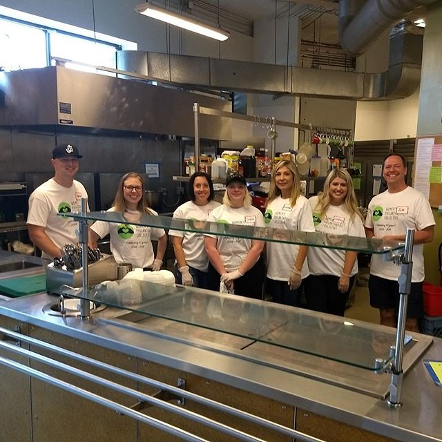 "Volunteers at YouthCare are deep cleaning the kitchen! Look for the ""after"" photo later! #wpcgivesback #wpcturns10"