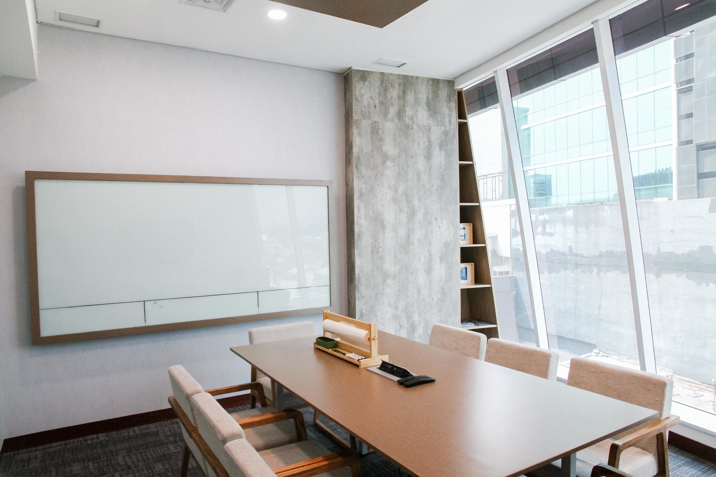 Our meeting rooms are designed with a combination of simple yet professional Scandinavian design and Indonesian wooden flair