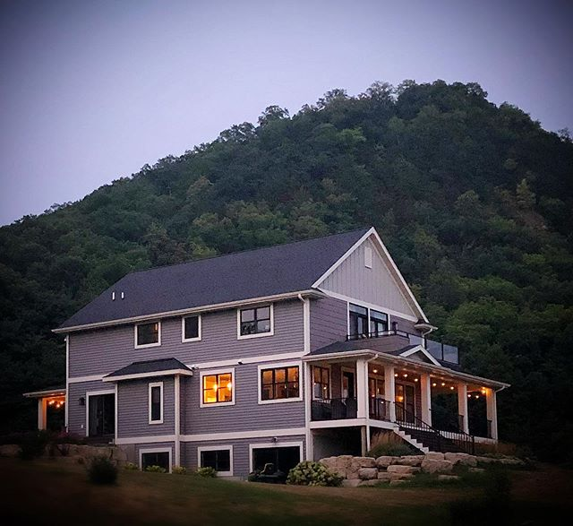 A Dubé STAY with bluffs on three sides and the Mississippi River in front. www.adubestay.com . #retreat #homeawayfromhome #vacationrental #stockholmwisconsin #travelwisconsin #discoverwisconsin #visitpepin #porches #balconies