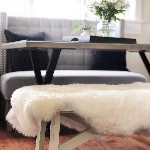 New dining comforts. . #furonbench #kitchentable #tablebench #bench #sheepskin #adubestay #stockholmwisconsin #luxuryrentals #vacationrental