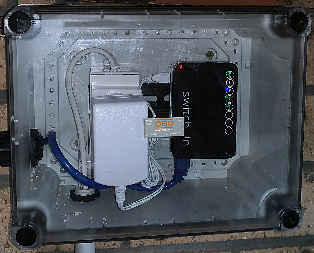 SwitchDin Droplet & power supply in a separate enclosure. The Droplet connects to the battery via an Ethernet cable.