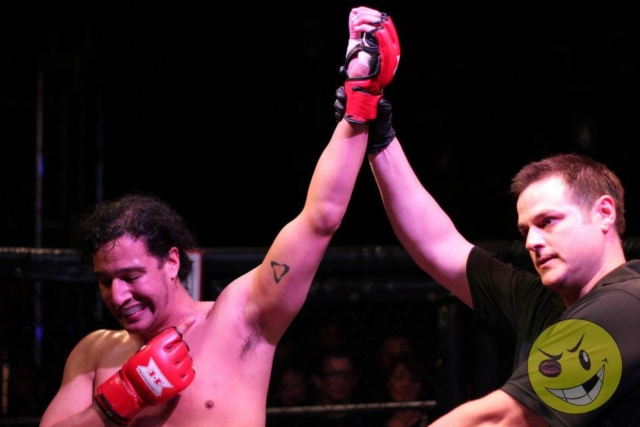 Elias with his hand raised after his May, 2012 first-round TKO victory in the United Combat League cage.
