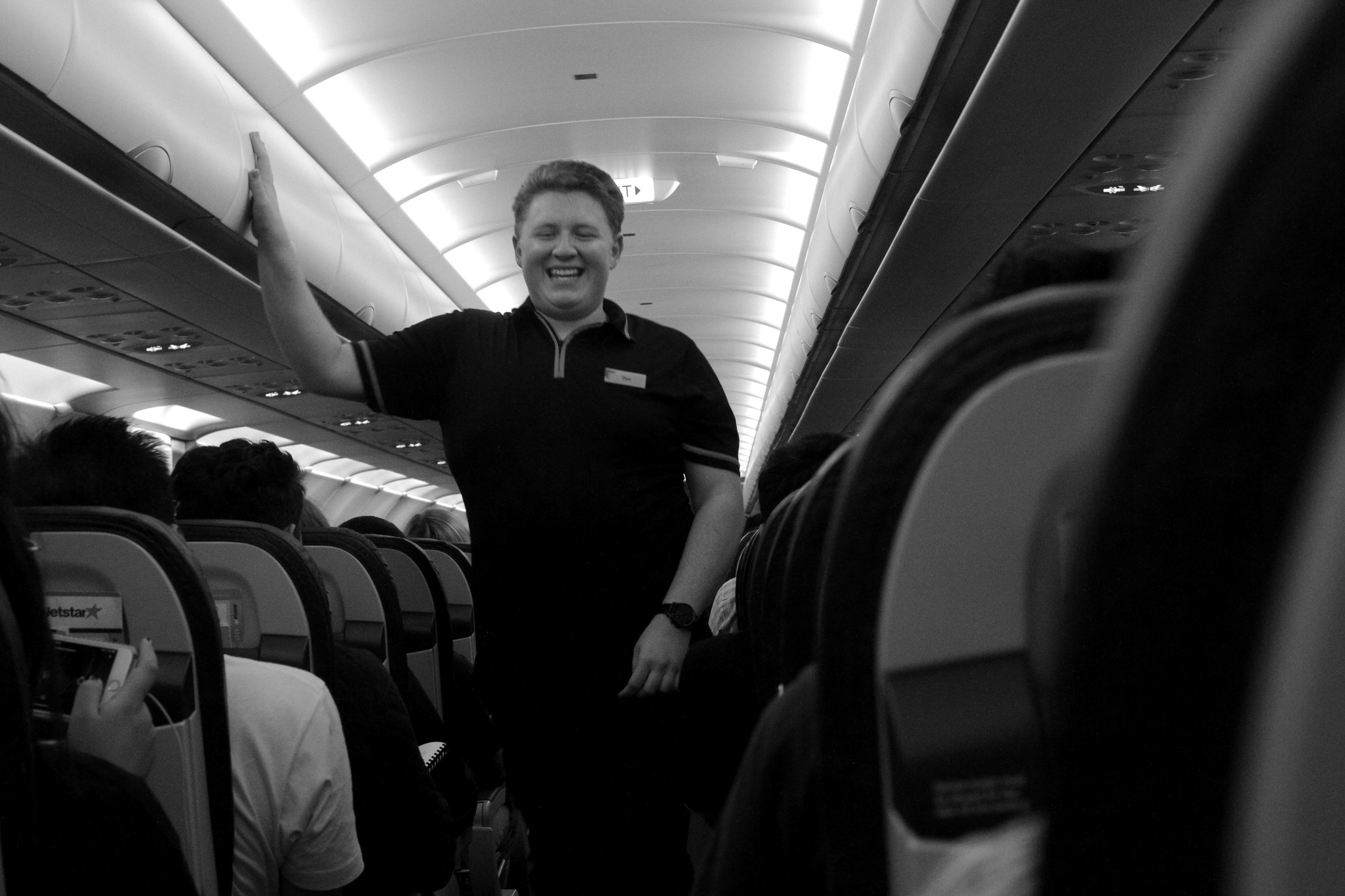 15. Our super happy flight attendant Thor ushering us home safely. On rock tour it is handy to be around people with happiness inside them.