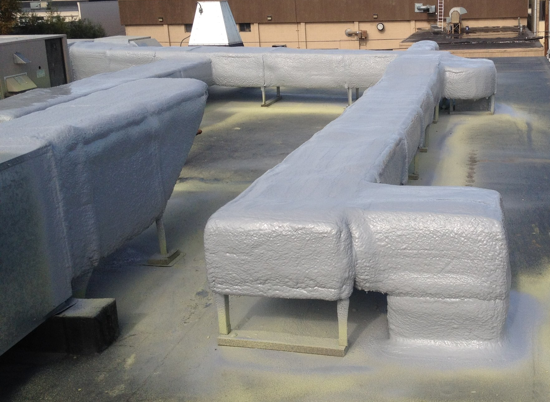 Urethane Alaska's quality of rooftop ductwork after applying urethane and Polyshield.