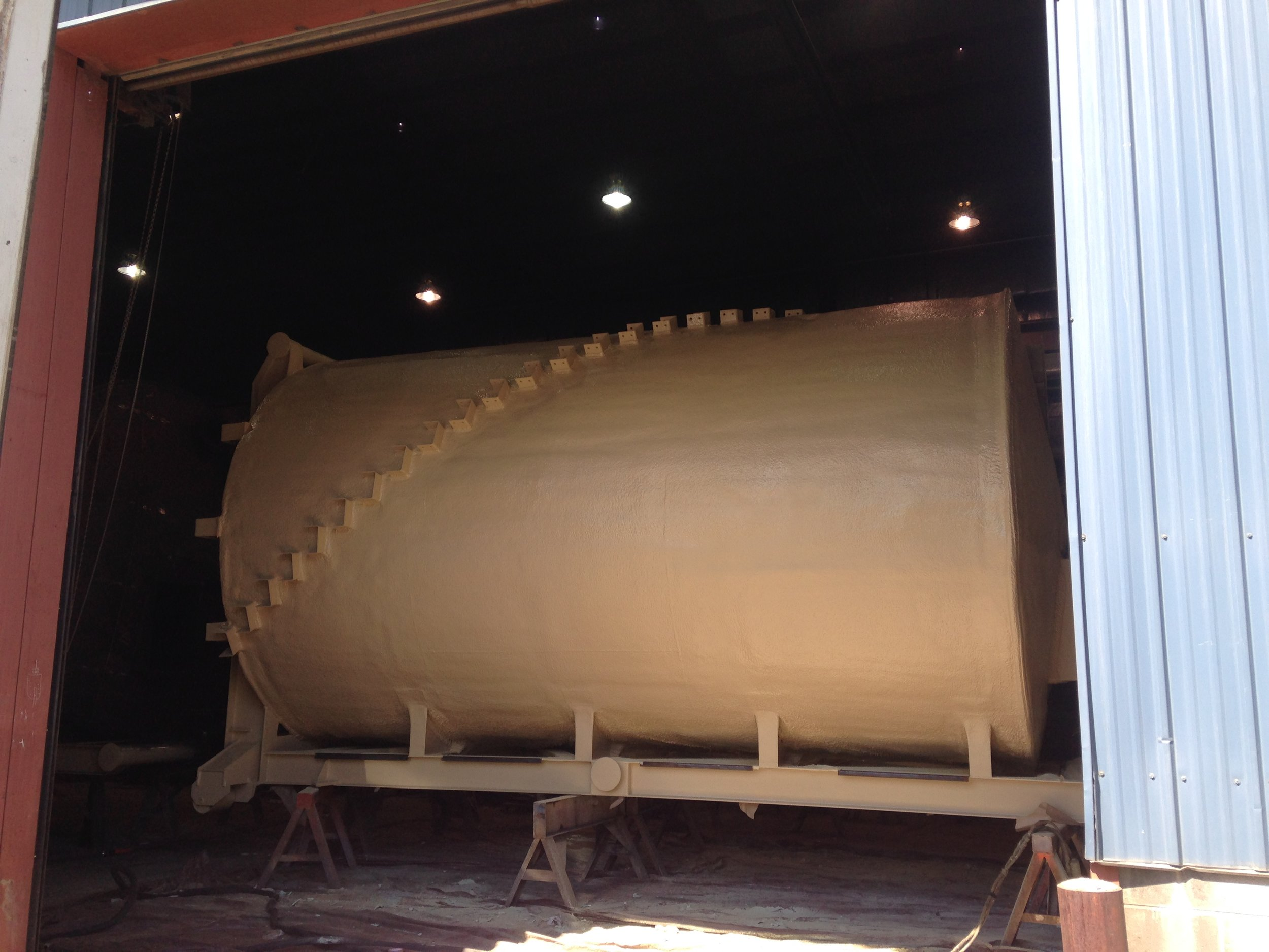 25,000 gallon fuel tank application with polyshield application following the urethane coating.