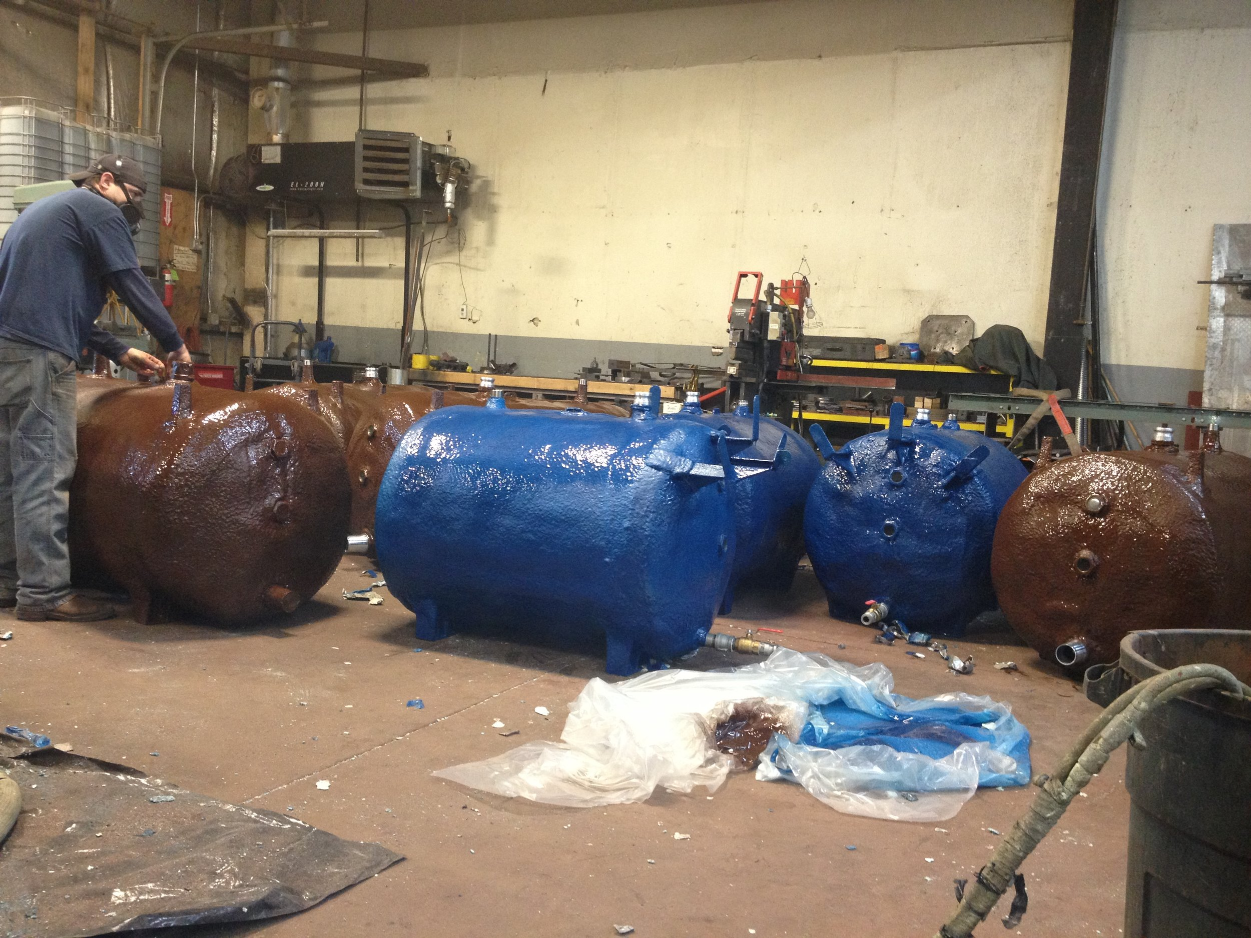 Urethane and polyshield applications for rural Alaska. The blue tanks are for fresh water usage while the brown tanks are for black water transportation.