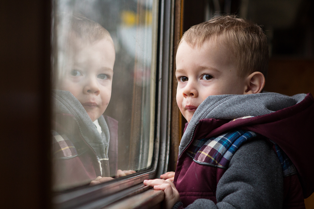 This reflection in the train window makes this photograph feel nostalgic, by concentrating on the angle I was able to get both sets of eyes looking into the camera.
