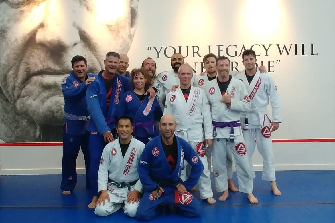 Denis (in the back) posing with the fine folks of Gracie Barra Jiu Jitsu in Vancouver. Professor Max (front center) had just finished instructing the morning BJJ class.