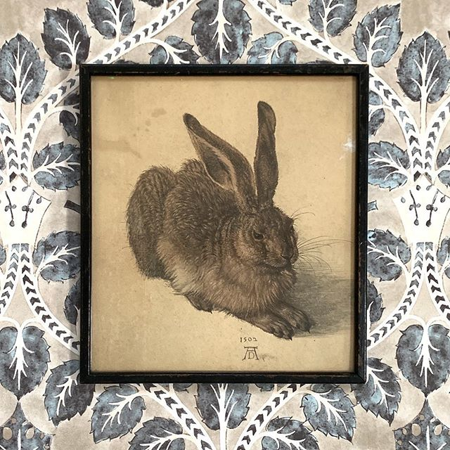 "An antique print of Albrecht Durer's masterpiece ""The Hare"" originally painted in 1502 was the very first picture that we ever sold.  We have just found another in its original frame shown here sitting beautifully on @lewisandwood Berry Brothers wallpaper in Cola. #albrechtdurer #hare #antiqueprints #art #interiors #interiordesign #gallerywall #interiordecor"