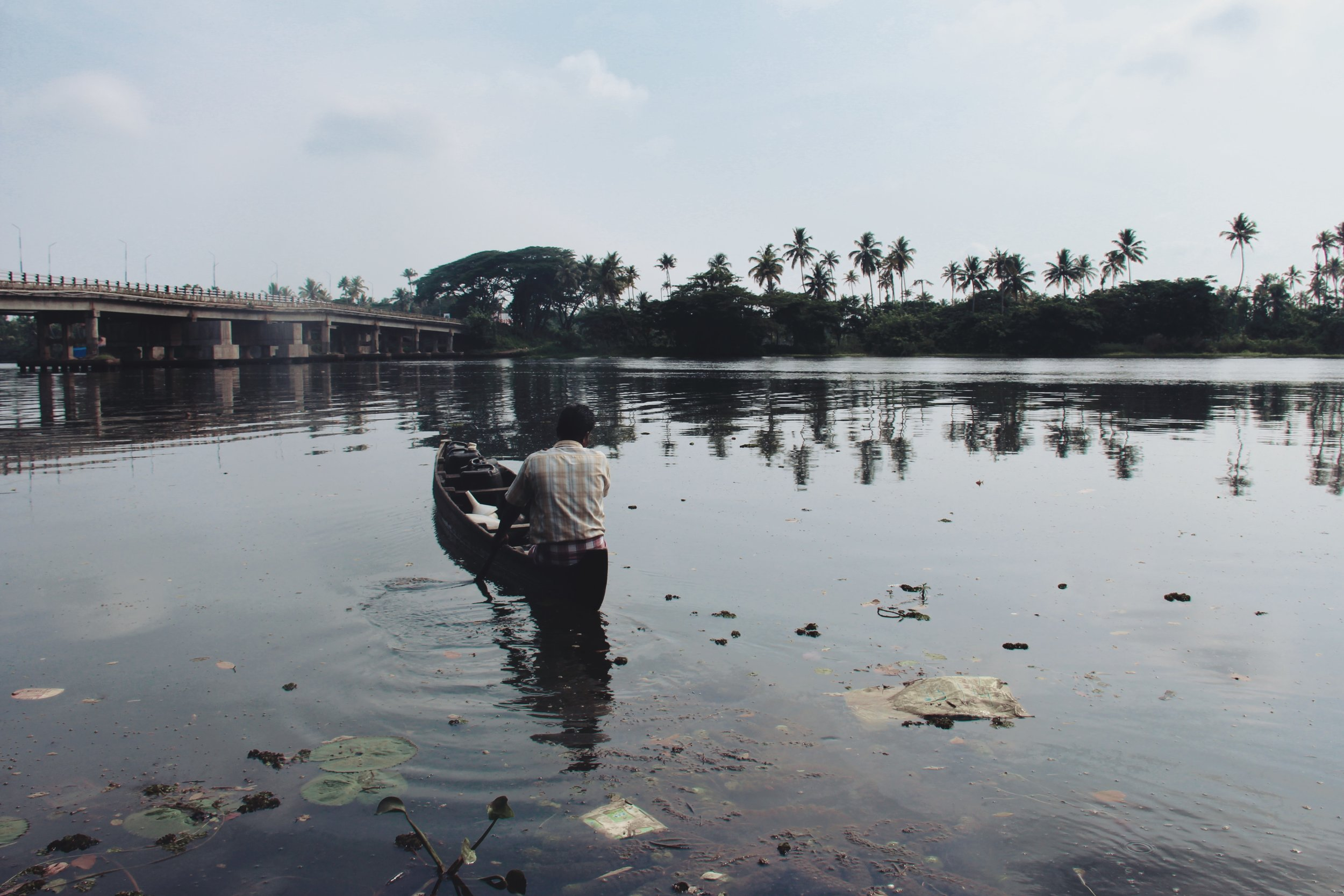 Signs of pollution across the backwaters of Alappuzha, Kerala.