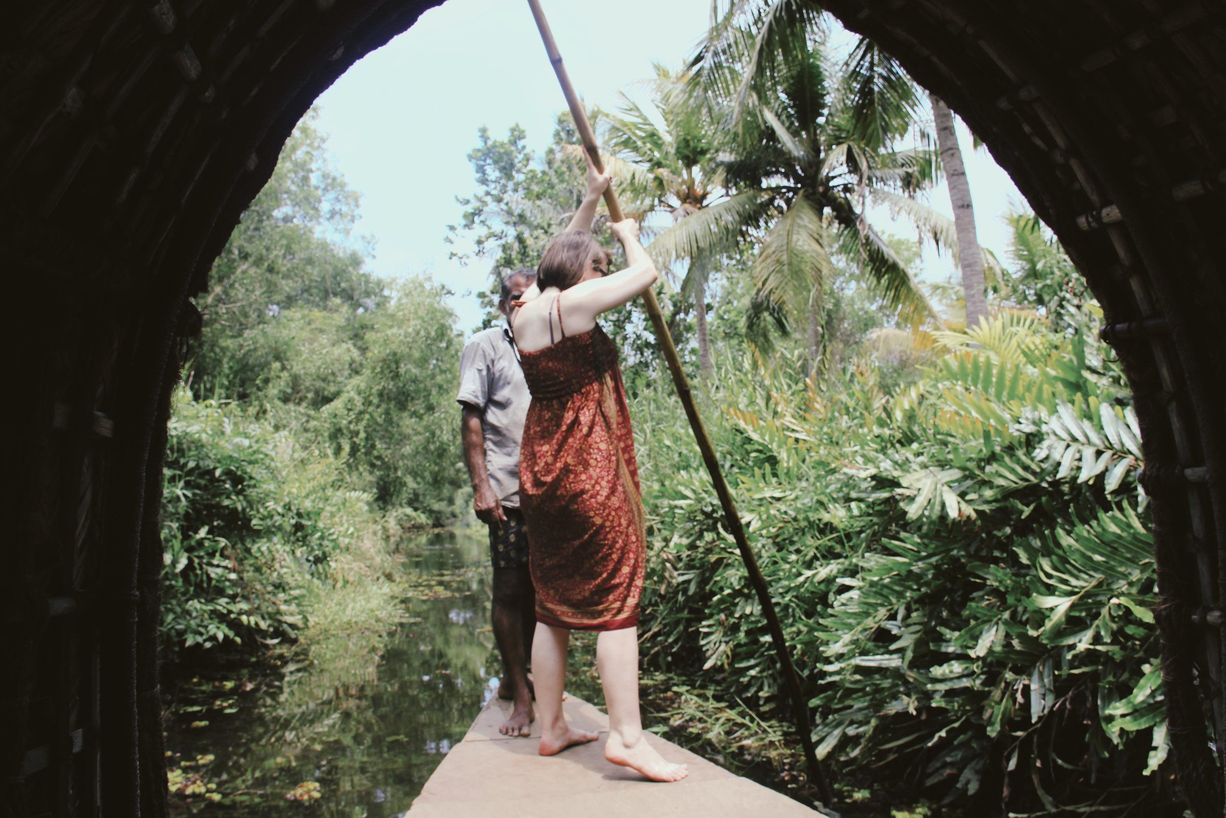 Learning how to steer a boat through the backwaters of Alappuzha, Kerala.