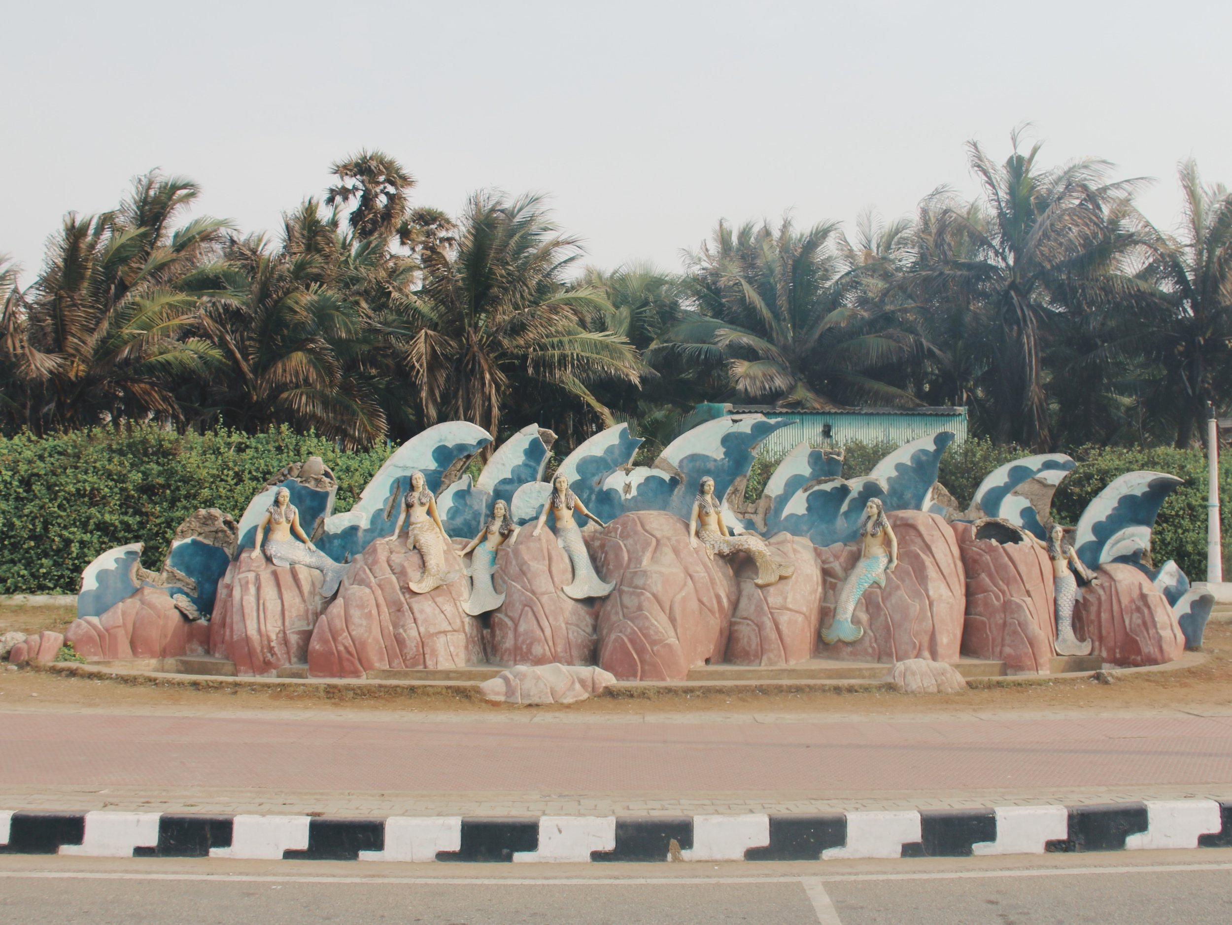 The entire seafront is lined with strange photo-op statues - like this group of mermaids.