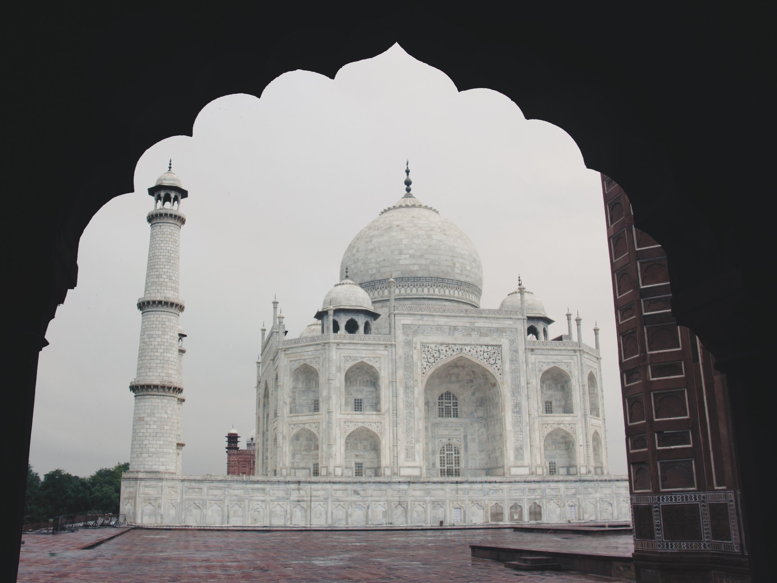 One final view of the Taj Mahal beautifully framed through the arch of a neighbouring building.