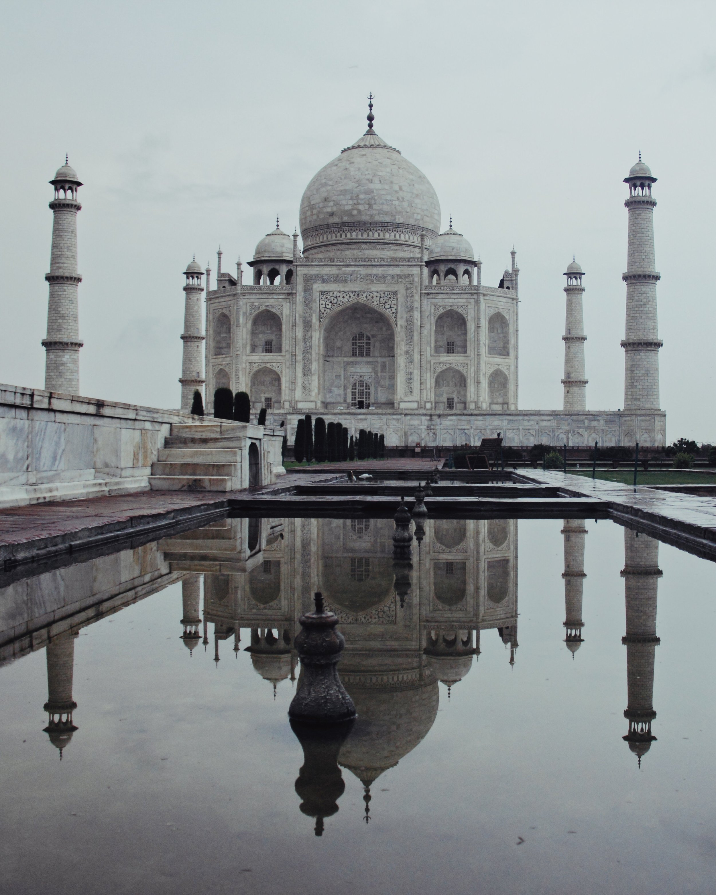 The Taj Mahal in Agra is made of ivory-white marble. It is a mausoleum commissioned by the Mughal Emperor Shah Jahan to house the tomb of his favourite wife Mumtaz Mahal, who was a Persian princess that passed away while giving birth to their 14th child.