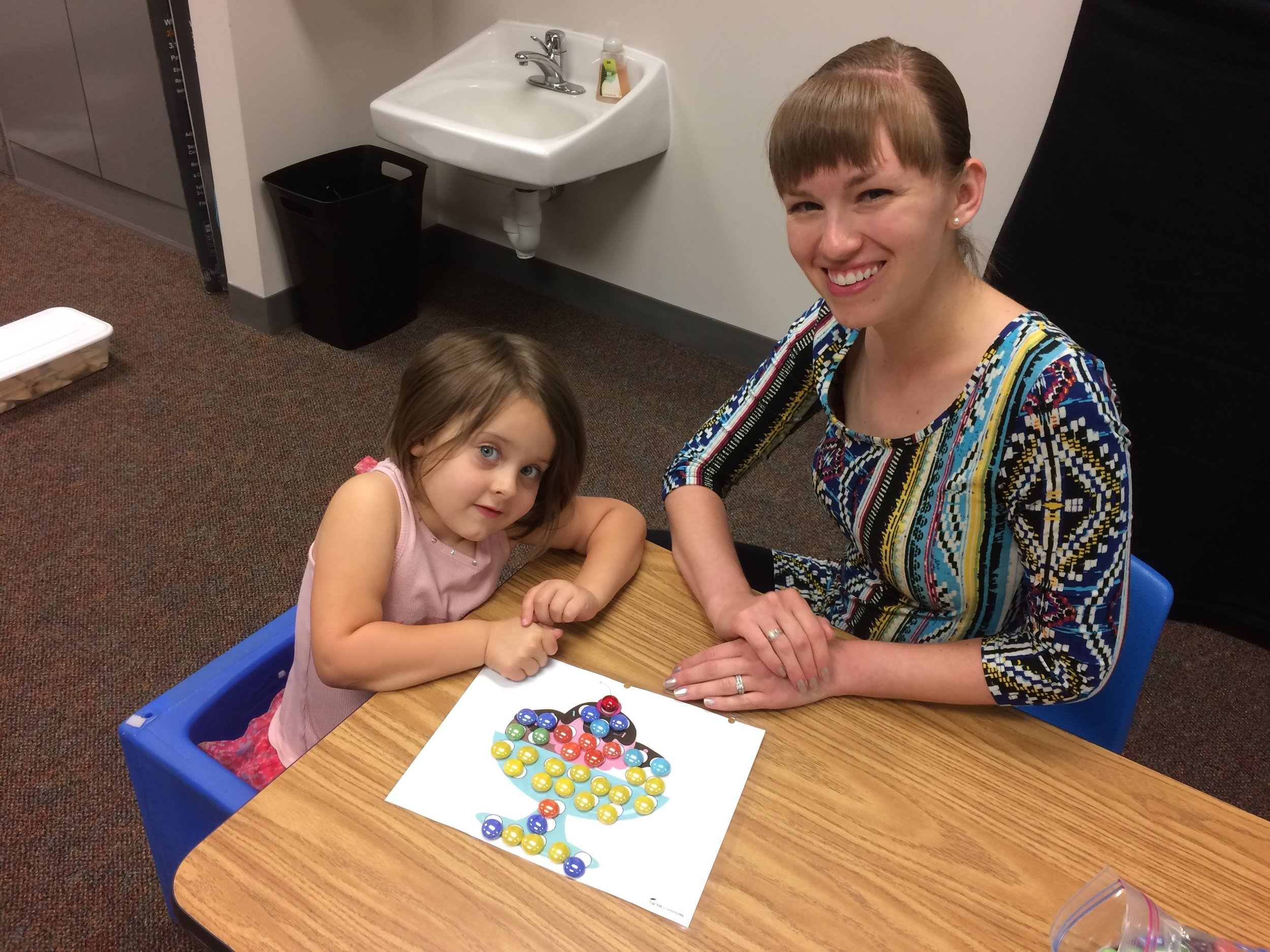 Holly Schlautman with Child at Lincoln Clinic 07.2017.jpg