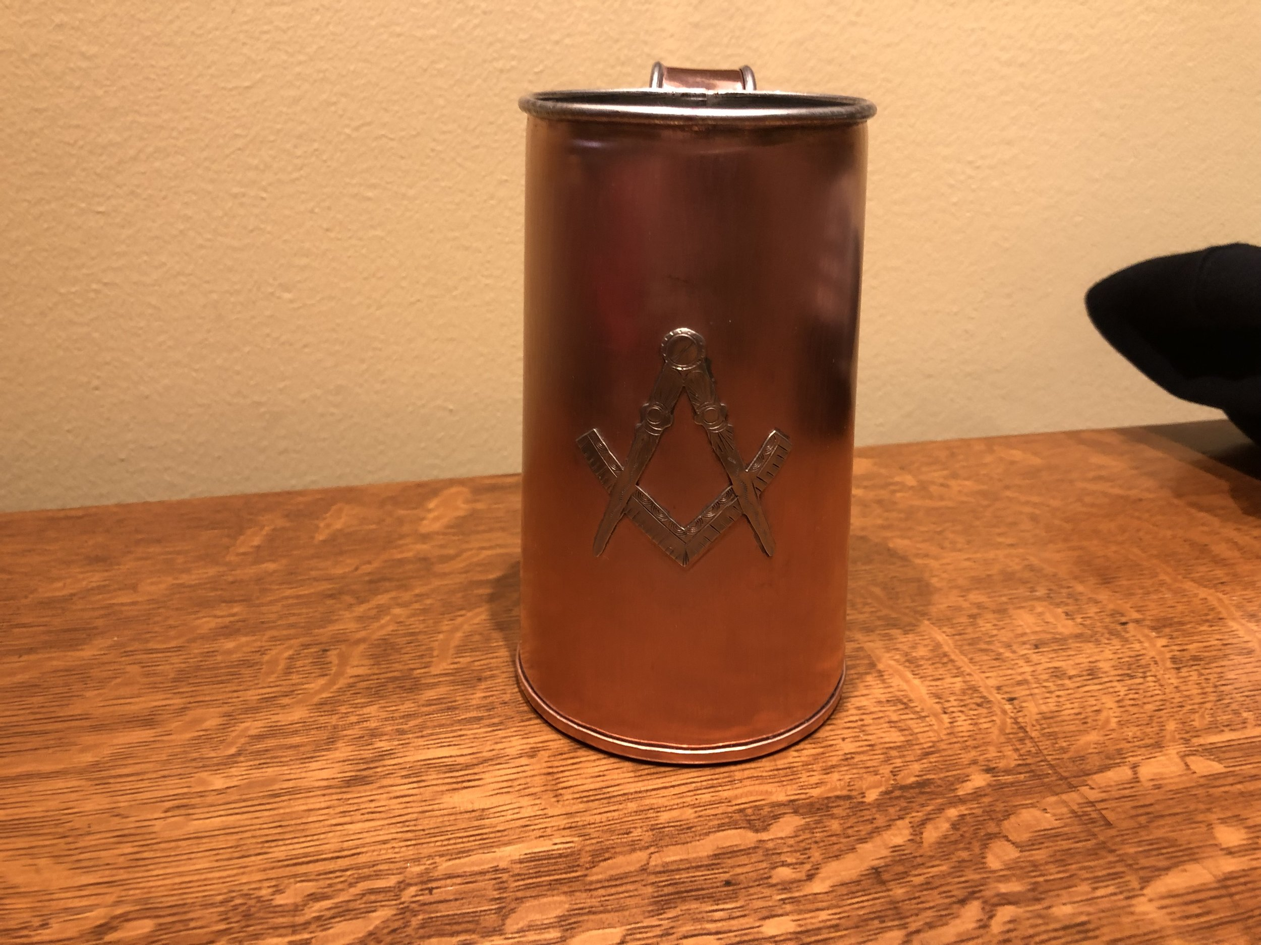 handmade copper tankard with Masonic Square and Compass