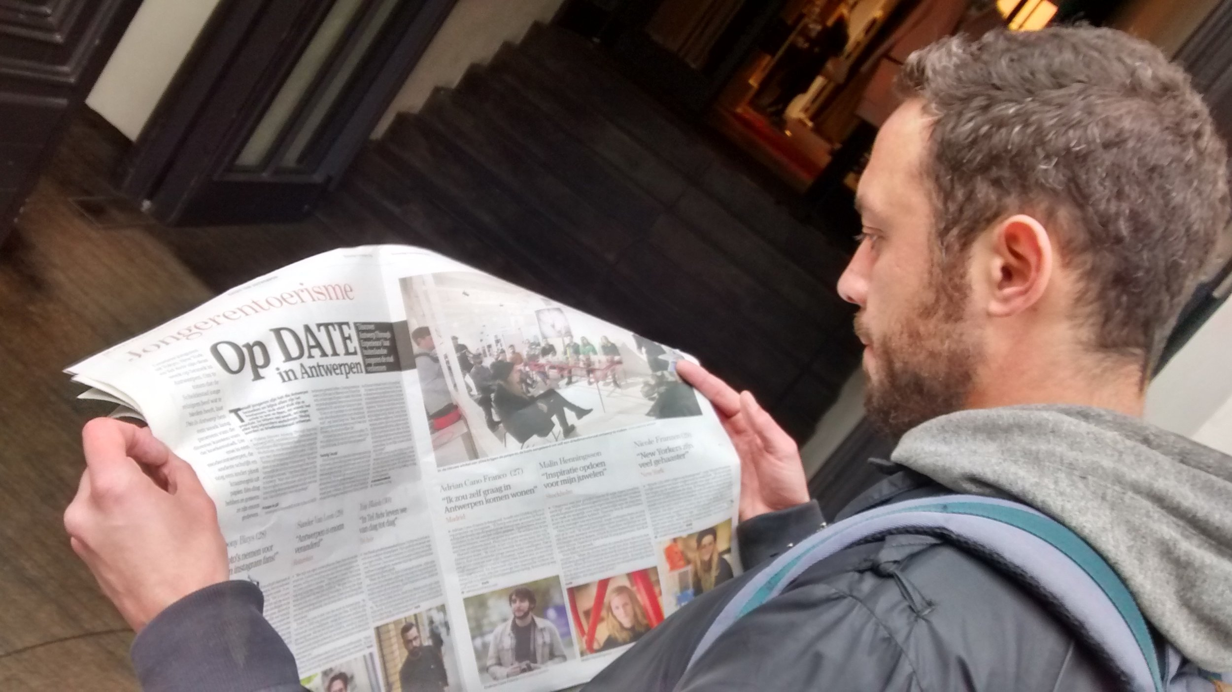 Me looking for myself in the local media coverage - Photo credit This is Antwerp