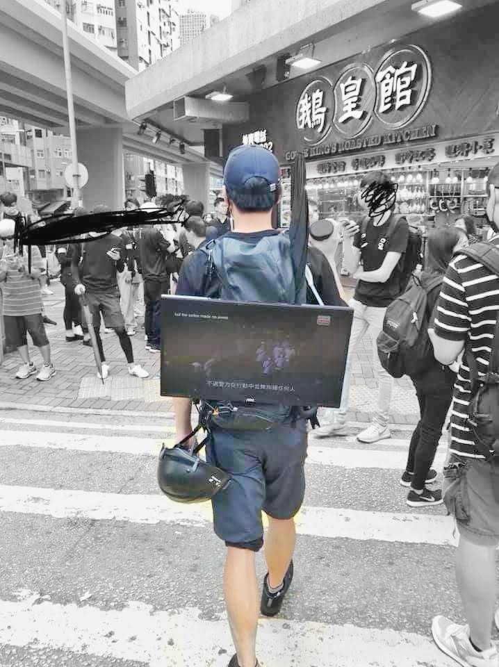 """A """"Lennon TV"""" that was carried around by protestor on his back to screen videos about the movement    Photo Source: Linkg Forum"""