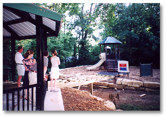 Neighbors view construction of the bridge connecting the Play Area with the Pavilion.