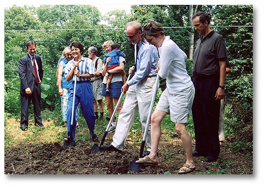 Park Board of Directors Sarah Kuhn, Larry Lenahan, and Sally McMahon break ground while Jocelyn Warren and Jim Watson wait their turn.