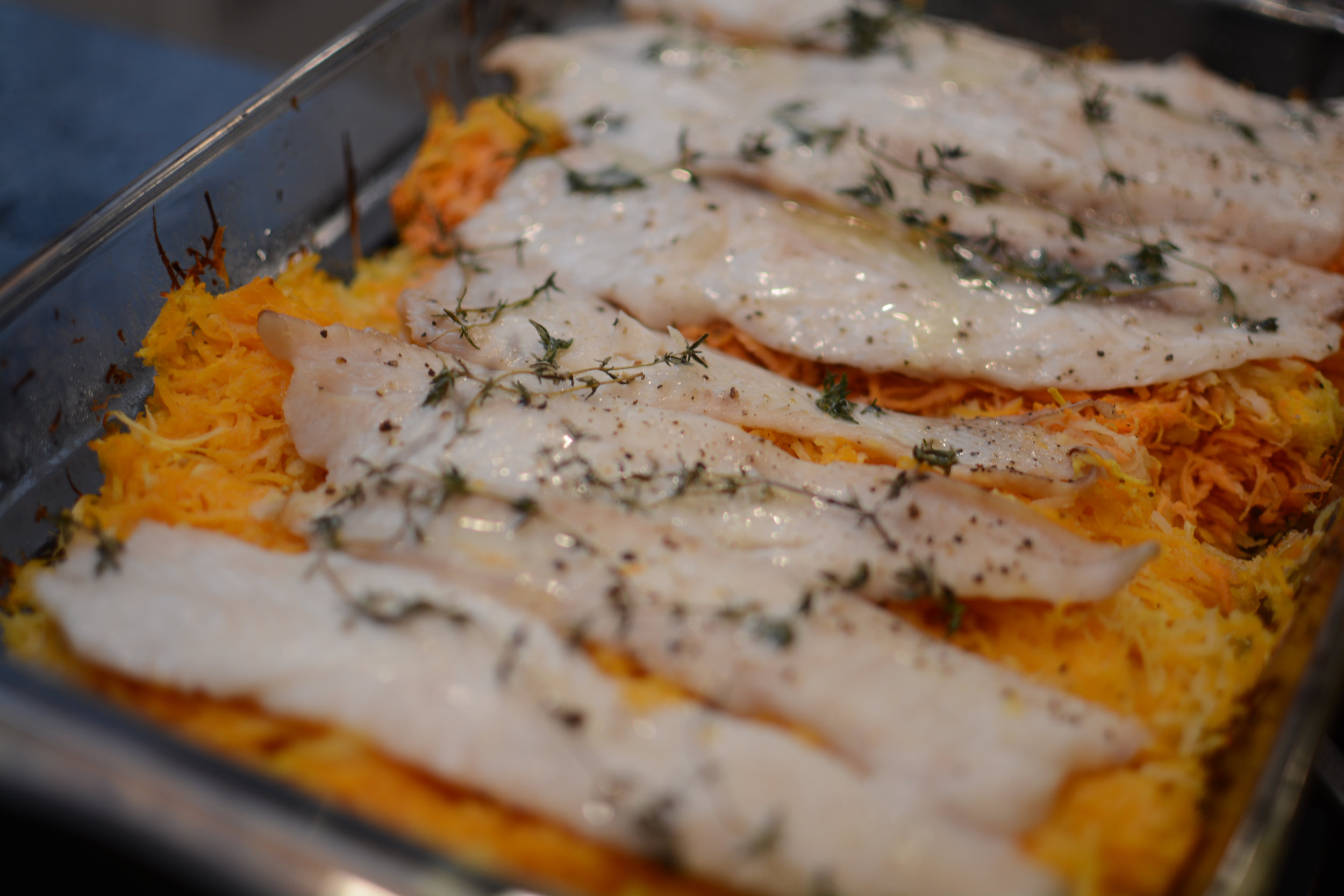 baked fish over vegetables