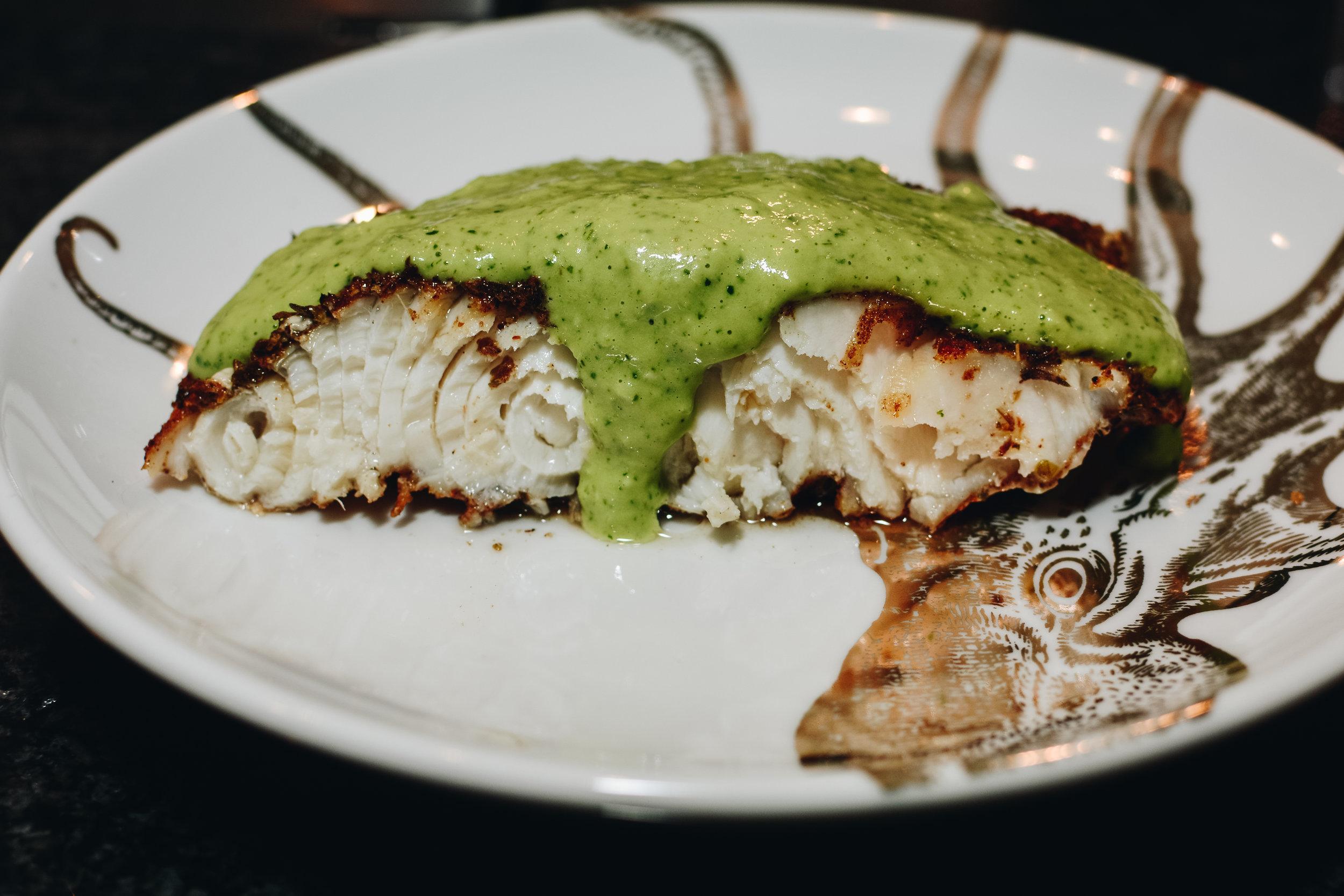 Sturgeon with avocado cream sauce
