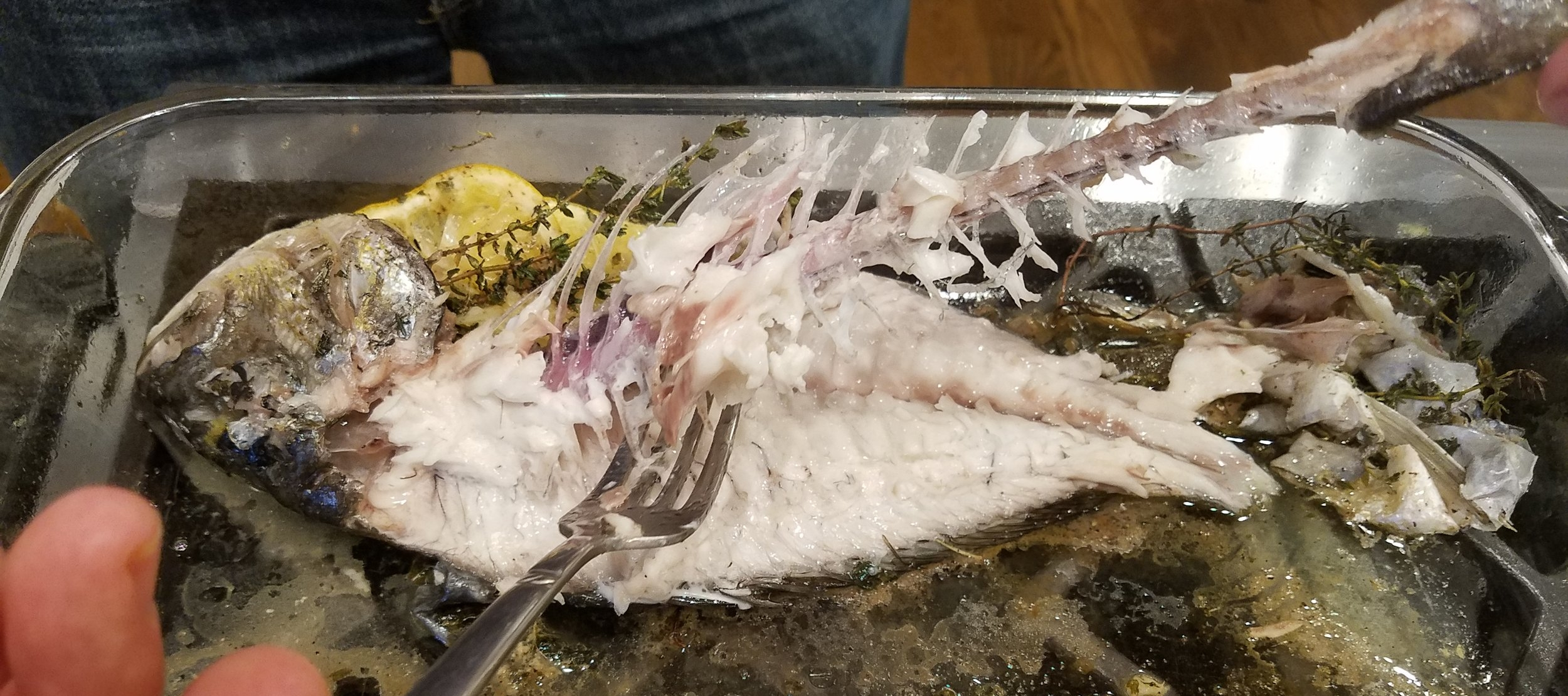 Most of the skeleton should lift out easily, but some bones will probably be left behind.  That is part of the deal when cooking this fish whole.  Look it over thoroughly and chew carefully.