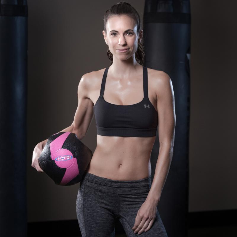 Model Amy Frena strikes a pose with our Hero Strength Dual-Handle Medicine Ball. Our medicine balls come a variety of colors and sizes starting out at 6 lbs. and going up to 20 lbs.