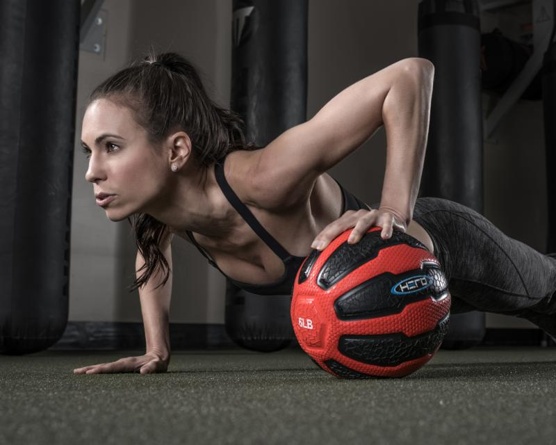 Amy uses a 6 lb. Hero Strength Medicine Ball to up the ante on the basic plank.
