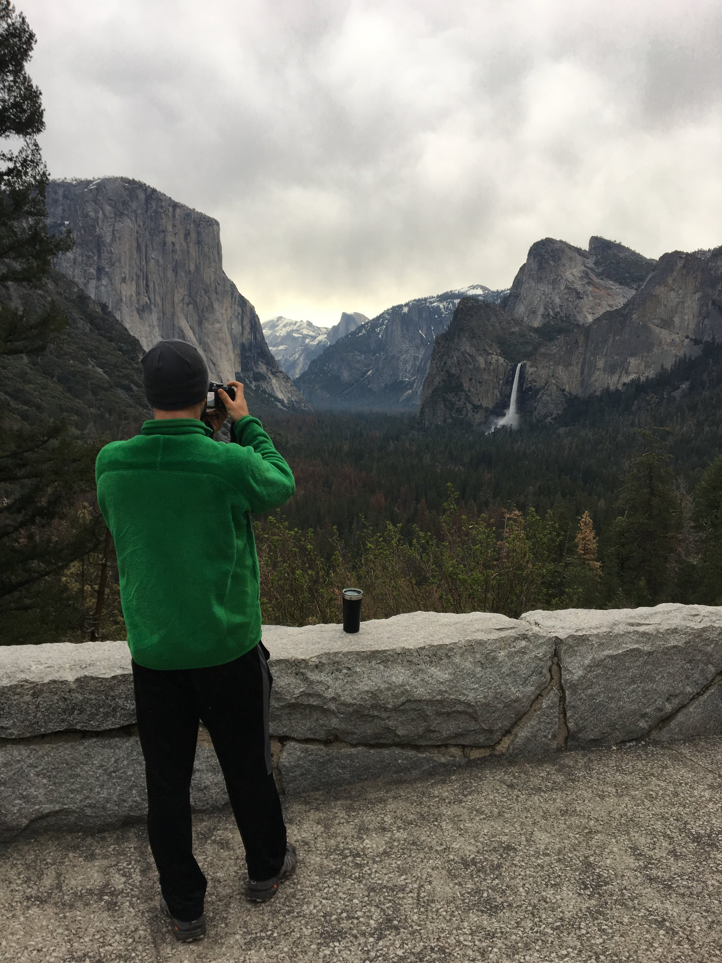 """My handsome photographer in his ugly green jacket (which I have dubbed """"The Grinch"""") photographing Tunnel View"""