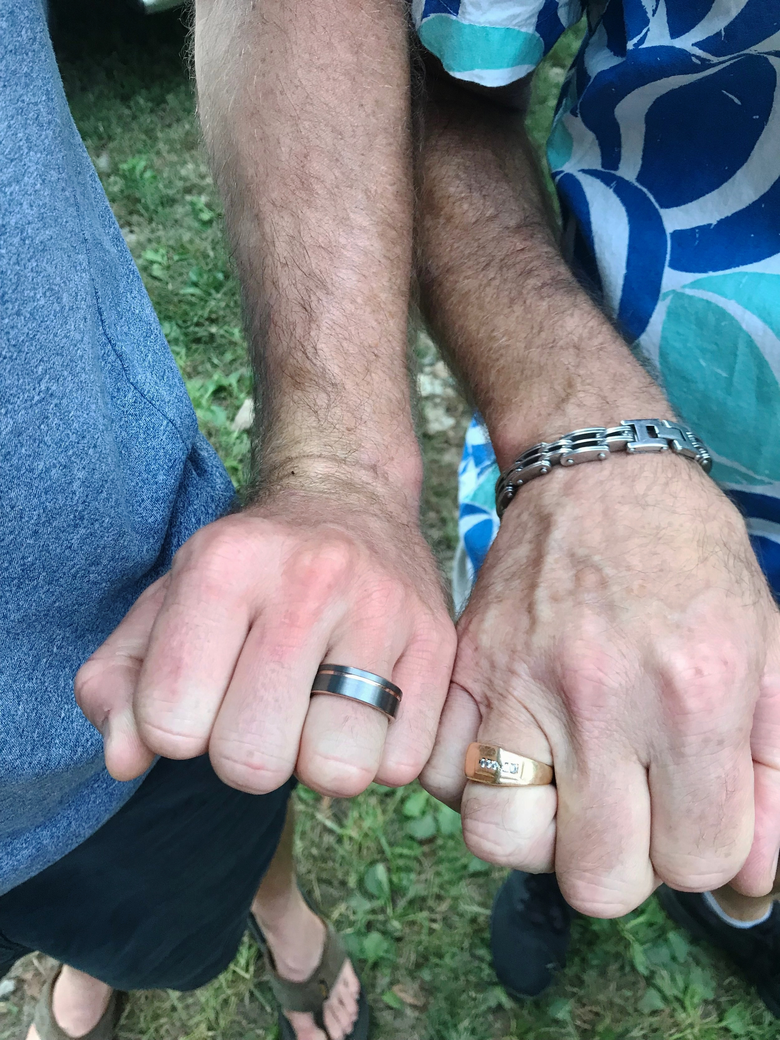 Nick's ring next to his Dad's