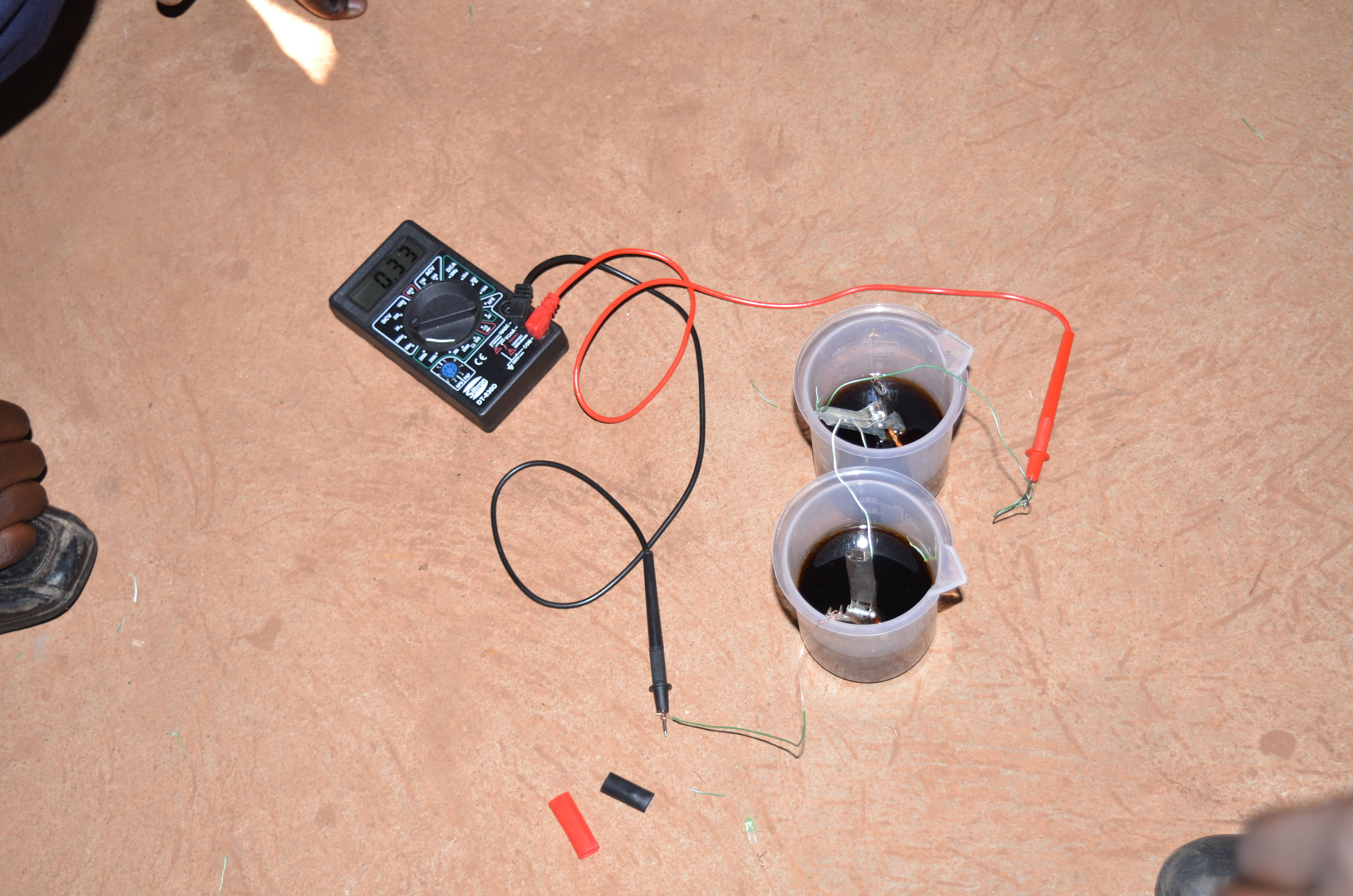 students experimenting how to make a battery from soda.JPG