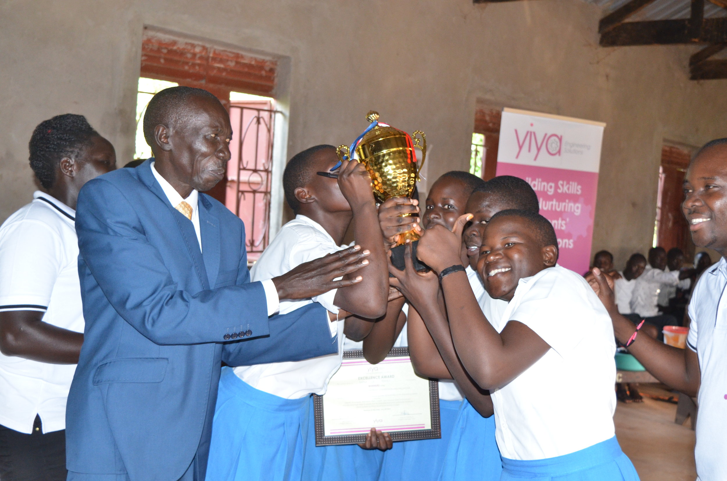 Rapha Girls School-the Winners receive their Gold trophy from the RDC.JPG